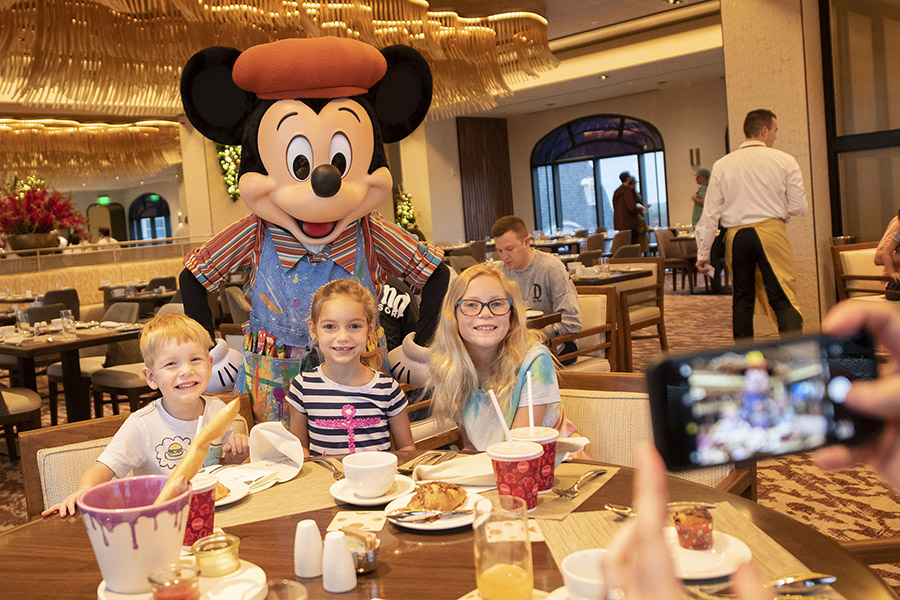 Mickey Mouse and family dining