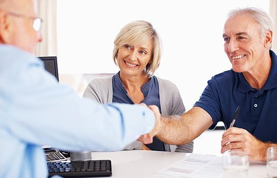 AAA Medicare Supplement Plans happy couple talking with advisor