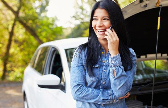 Happy AAA member, calling for roadside assistance.