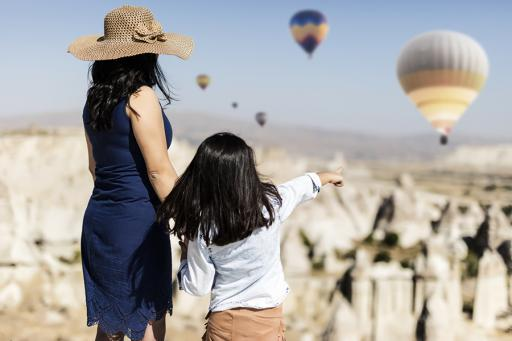 Mother and daughter looking at hot air balloons