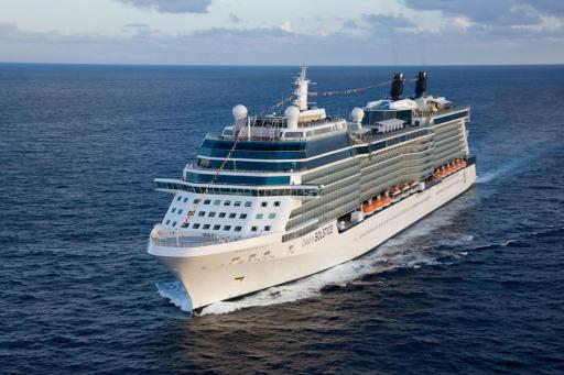 White cruiseship sailing on the ocean on beautiful blue seas