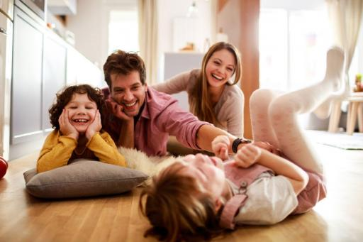 Happy family playing on the floor