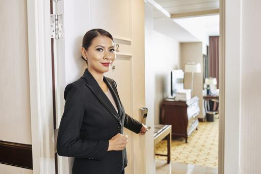 Hotel Room, beautiful lady opening a hotel room door