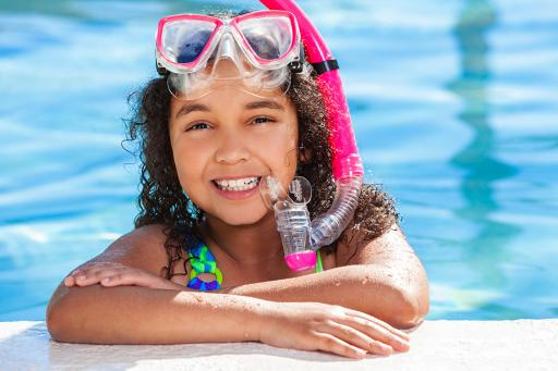 GIrl in the pool with a snorkel