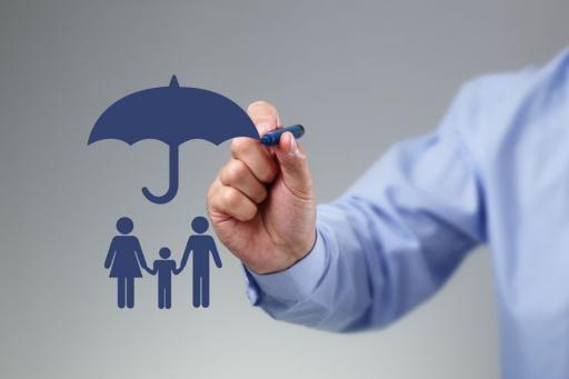 Umbrell insurance - man drawing a blue umbrella on a gray screen